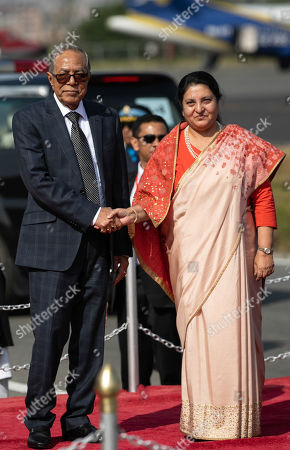 President of Bangladesh, Abdul Hamid (L) and President of Nepal, Bidhya Devi Bhandari (R) shake hands during a welcome ceremony at Tribhuvan International Airport.