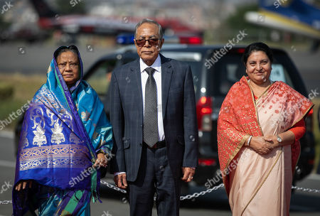 Stock Photo of President of Bangladesh, Abdul Hamid (c) and President of Nepal, Bidhya Devi Bhandari (R) and the first lady of Bangladesh Rashida Hamid (L) pose for pictures upon their arrival at Tribhuvan International Airport in Kathmandu