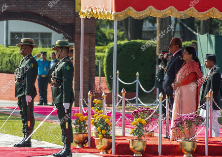 President of Bangladesh, Abdul Hamid (C, left) and Nepal's President, Bidhya Devi Bhandari (C, right) Received by the guard of honour during a welcome ceremony at Tribhuvan International Airport