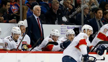 Florida Panthers head coach Joel Quenneville looks on from the bench during an NHL hockey game against the New York Islanders, in New York