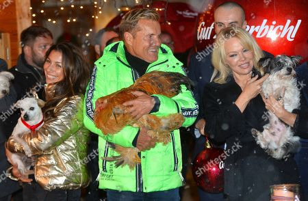 Dieter Bohlen and his partner Fatma Carina Walz with Pamela Anderson