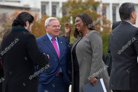 United States Senator Bob Menendez (Democrat of New Jersey) speaks to New York Attorney General Letitia James after the Supreme Court heard arguments on the Deferred Action for Childhood Arrivals program in Washington DC