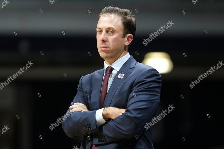 Minnesota head coach Richard Pitino watches from the sideline as his team played Butler in the second half of an NCAA college basketball game in Indianapolis, . Butler won 64-56