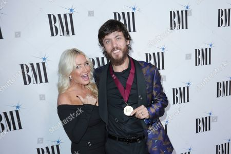 Chris Janson, Kelly Lynn. Chris Janson, right, and his wife, Kelly Lynn, arrive at 67th Annual BMI Country Awards ceremony at BMI Music Row offices, in Nashville, Tenn