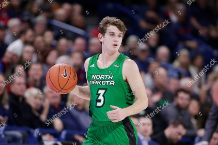 North Dakota guard Billy Brown (3) brings the ball up the court during the first half of an NCAA college basketball game against Gonzaga in Spokane, Wash
