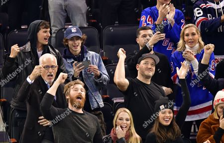 Timothée Chalamet, Gregg Bello, Jose Batista and Alexandra Long  attend Pittsburgh Penguins vs New York Rangers game at Madison Square Garden