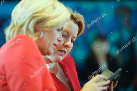 German Minister for Family Affairs, Senior Citizens, Women and Youth, Franziska Giffey, right, and German Agriculture Minister, Julia Kloeckner, left, talk as they arrive for the weekly cabinet meeting at the chancellery in Berlin, Germany