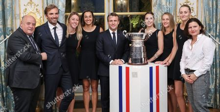 President of the French Tennis Federation (FFT) Bernard Giudicelli, France Fed Cup Captain Julien Benneteau, Pauline Parmentier, Caroline Garcia, French President Emmanuel Macron, Alize Cornet, Fiona Ferro, Kristina Mladenovic and French Sports Minister Roxana Maracineanu pose during a reception at the Elysee presidential palace in Paris, two days after they won the Fed Cup tennis competition