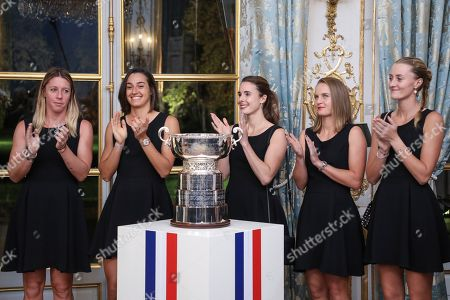 From the left, Pauline Parmentier, Caroline Garcia, Alize Cornet, Fiona Ferro and Kristina Mladenovic, of the French women tennis team, applaud during a reception at the Elysee presidential palace in Paris, two days after they won the Fed Cup tennis competition