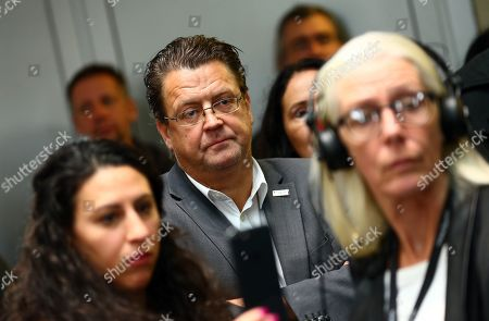 Stephan Brandner (C) of the Alternative for Germany (AfD) right-wing populist party looks on after the meeting of the Legal Affairs Committee of the Bundestag, in Berlin, Germany, 13 November 2019. The Committee on Legal Affairs of the Bundestag relieved its chairman Stephan Brandner of the office. The AfD politician from Thuringia had provoked outrage with his reactions to the terrorist attack in Halle. The Bundestag has officially reprimanded Brandner. Most recently, he vilified the awarding of the Federal Cross of Merit to the AfD-critical German rock singer Udo Lindenberg as a 'Judas rewarding'.