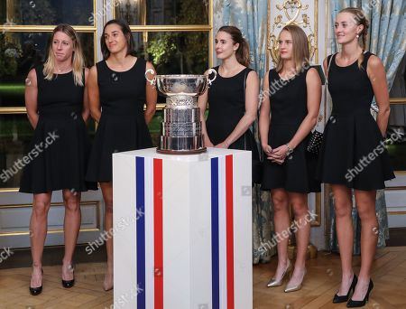 (From L) Pauline Parmentier, Caroline Garcia, Alize Cornet, Fiona Ferro and Kristina Mladenovic of the French women tennis team listen to French President delivering a speech during a reception at the Elysee presidential palace in Paris, France, 12 November 2019 (issued 13 November 2019), two days after they won the Fed Cup competition.