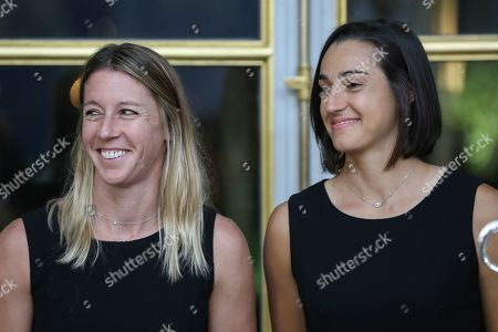 (From L) Pauline Parmentier and Caroline Garcia of the French women tennis team pose during a reception at the Elysee presidential palace in Paris, France, 12 November 2019 (issued 13 November 2019), two days after they won the Fed Cup competition.