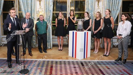 (From L) French President Emmanuel Macron delivers a speech next to France Fed Cup Captain Julien Benneteau, President of the French Tennis Federation (FFT) Bernard Giudicelli, French tennis teacher Stanislas Kuchna, Pauline Parmentier, Caroline Garcia, Alize Cornet, Fiona Ferro, Kristina Mladenovic of the French women tennis team and French Sports Minister Roxana Maracineanu during a reception at the Elysee presidential palace in Paris, France, 12 November 2019 (issued 13 November 2019), two days after they won the Fed Cup competition.