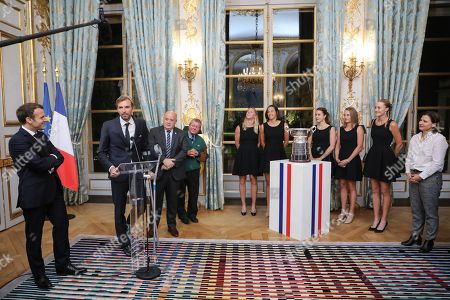Stock Image of (From L) French President Emmanuel Macron listens to France Fed Cup Captain Julien Benneteau delivering a speech next to President of the French Tennis Federation (FFT) Bernard Giudicelli, French tennis teacher Stanislas Kuchna, Pauline Parmentier, Caroline Garcia, Alize Cornet, Fiona Ferro, Kristina Mladenovic of the French women tennis team and French Sports Minister Roxana Maracineanu during a reception at the Elysee presidential palace in Paris, France, 12 November 2019 (issued 13 November 2019), two days after they won the Fed Cup competition.