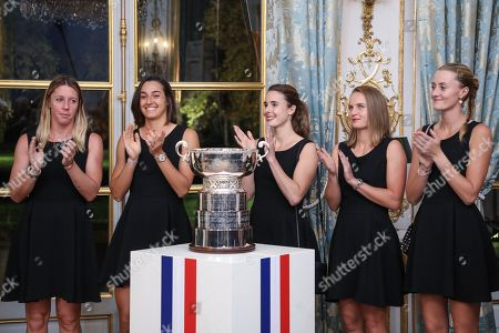 (From L) Pauline Parmentier, Caroline Garcia, Alize Cornet, Fiona Ferro and Kristina Mladenovic of the French women tennis team applause as they listen to French President delivering a speech during a reception at the Elysee presidential palace in Paris, France, 12 November 2019 (issued 13 November 2019), two days after they won the Fed Cup competition.