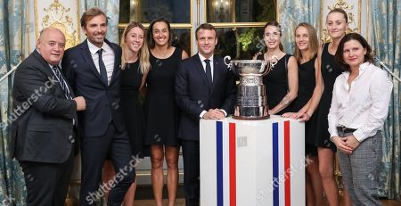 (From L) President of the French Tennis Federation (FFT) Bernard Giudicelli, France Fed Cup Captain Julien Benneteau, Pauline Parmentier, Caroline Garcia, French President Emmanuel Macron, Alize Cornet, Fiona Ferro, Kristina Mladenovic and French Sports Minister Roxana Maracineanu pose for a picture during a reception at the Elysee presidential palace in Paris, France, 12 November 2019 (issued 13 November 2019), two days after they won the Fed Cup competition.