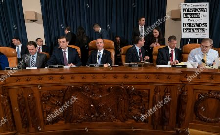 Jim Himes, Adam Schiff, Devin Nunes, Jim Jordan, Steve Castor, Daniel Goldman. From left, Rep. Jim Himes, D-Conn., Daniel Goldman, director of investigations for the House Intelligence Committee Democrats, House Intelligence Committee Chairman Adam Schiff, D-Calif., Rep. Devin Nunes, R-Calif, the ranking member, Steve Castor, the Republican's staff attorney, and Rep. Jim Jordan, R-Ohio, gather for the opening of the the first public impeachment hearing of President Donald Trump's efforts to tie U.S. aid for Ukraine to investigations of his political opponents, on Capitol Hill in Washington