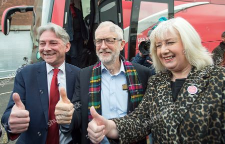 Labour leader Jeremy Corbyn arrives with the Labour battle bus with Scottish labour leader Richard Leonard (L) and Labour candidate Patricia Ferguson (R) for a visit to the Heart of Scotstoun in Glasgow, Britain, 13 November 2019. Britons go the polls 12 December in a general election.