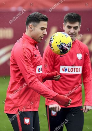 Polish national soccer team players Jan Bednarek (L) and Krzysztof Piatek (R) warm up during a team training session in Warsaw, Poland, 13 November 2019. Poland will face Israel on 16 November and Slovenia on 19 November 2019 in their UEFA EURO 2020 qualifying soccer matches.