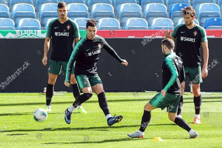 Portuguese players (L-R) Andre Silva, Cristiano Ronaldo, Bernardo Silva, and Ruben Dias perform during their team's training session at Algarve Stadium in Faro, Portugal, 13 November 2019. Portugal will face Lithuania on 14 November and Luxembourg on 17 November 2019 in their UEFA EURO 2020 qualifying soccer matches.