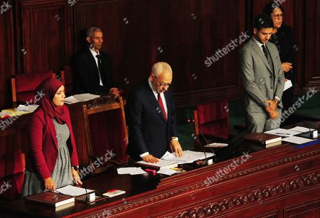 New Tunisian National Assembly house speaker Rached Ghannouchi takes oath on the Quran during the first session of the chamber, Wednesday Nov.13, 2019 in Tunis. Tunisia's new parliament opened with a session to elect a speaker after last month's election