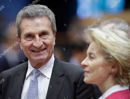Ursula von der Leyen (R), the nominated President of the European Commission, and EU Budget Commissioner, Guenther Oettinger (L) during a ceremony for the 30th anniversary of the fall of the Berlin Wall during a mini plenary session of the European Parliament in Brussels, Belgium, 13 November 2019.