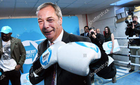 Brexit Party leader Nigel Farage (C) campaigns at boxing gym with British Boxer Dereck Chisora in Essex, east London, Britain, 13 November 2019. Britons go the polls 12 December in a general election.