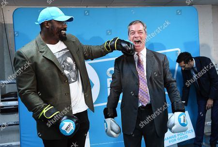 Brexit Party leader Nigel Farage (R) campaigns at boxing gym with British Boxer Dereck Chisora (L) in Essex, east London, Britain, 13 November 2019. Britons go the polls 12 December in a general election.