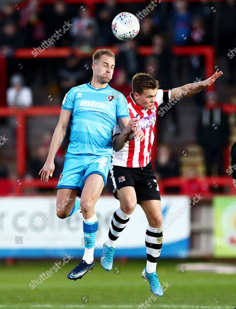 Luke Varney of Cheltenham Town and Dean Moxey of Exeter City.