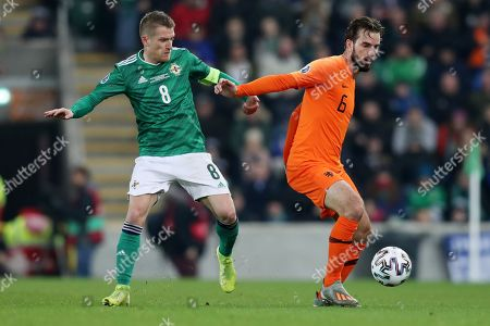 Davy Propper of Netherlands and Steven Davies of Northern Ireland