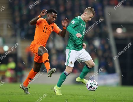 Stock Picture of Quincy Promes of Netherlands and Steven Davies of Northern Ireland