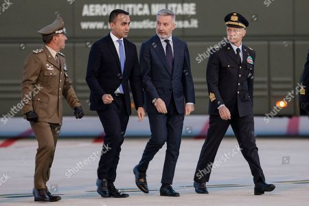 Italian Foreign Minister, Luigi di Maio, 2nd left, and Defense Minister Lorenzo Guerini, 2nd right, arrive at the Ciampino military airport, near Rome, . Five Italian military members that were wounded last Sunday in northern Iraq as they returned from a mission aimed at helping Iraqi troops combat the Islamic State group, landed at the Ciampino military airport Wednesday