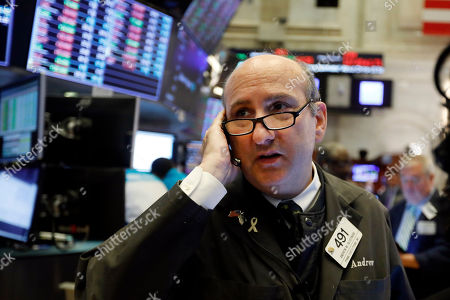 Trader Andrew Silverman works on the floor of the New York Stock Exchange, . Stocks are opening slightly lower on Wall Street led by declines in banks and industrial companies