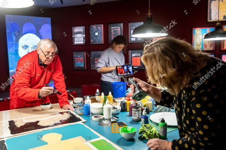 British film director Peter Greenaway (L) and his wife Saskia Boddeke (R) work during the World of Saskia Boddeke & Peter Greenaway exhibition at the at the Centre Of Contemporary Art in Torun, Poland, 13 November 2019. The Exhibition will run until 01 March 2020.