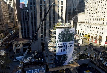 Stock Image of IMAGE DISTRIBUTED FOR TISHMAN SPEYER - Workers secure the 2019 Swarovski Star to the top of the 77-foot Rockefeller Center Christmas tree, in New York. The iconic star has been reimagined by architect Daniel Libeskind and features 3 million Swarovski crystals on 70 illuminated spikes. The 87th Rockefeller Center Christmas Tree Lighting ceremony will take place on Wednesday, Dec. 4