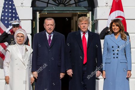 US President Donald Trump (2-R) and First Lady Melania Trump (R) greet Turkish President Recep Tayyip Erdogan (2-L) and his wife Emine Gulbaran (L) upon their arrival at the South Portico of the White House in Washington, DC, USA, 13 November 2019. The visit comes one month after Turkey's invasion into northern Syria against the Kurds and on the first day of public impeachment hearings.