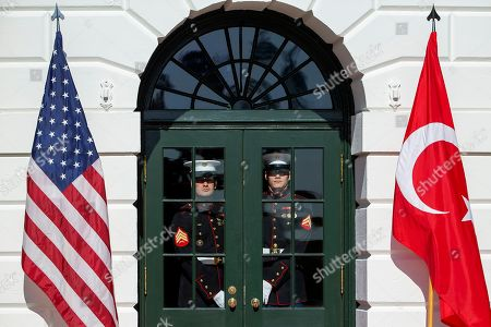 US Marines pause at the doorway before US President Donald J. Trump and First Lady Melania Trump greet Turkish President Recep Tayyip Erdogan and his wife, Emine Erdogan at the South Portico of the White House in Washington, DC, USA, 13 November 2019. The visit comes one month after Turkey's invasion into northern Syria against the Kurds and on the first day of public impeachment hearings.