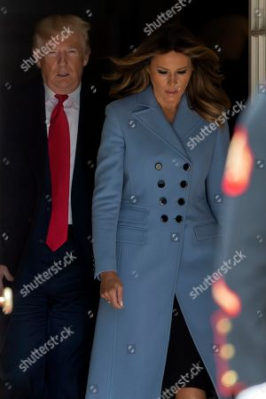 US President Donald Trump (L) and First Lady Melania Trump (R) come outside to greet Turkish President Recep Tayyip Erdogan and his wife, Emine Erdogan for their arrival at the South Portico of the White House in Washington, DC, USA, 13 November 2019. The visit comes one month after Turkey's invasion into northern Syria against the Kurds and on the first day of public impeachment hearings.
