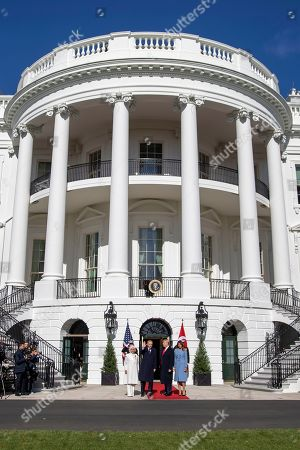 US President Donald J. Trump (2R) and First Lady Melania Trump (R) greet Turkish President Recep Tayyip Erdogan (2L) and his wife, Emine Erdogan (L) upon their arrival at the South Portico of the White House in Washington, DC, USA, 13 November 2019. The visit comes one month after Turkey's invasion into northern Syria against the Kurds and on the first day of public impeachment hearings.