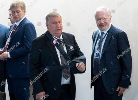 Kremlin spokesman Dmitry Peskov, left, Russian Rosneft Russian oil giant chief Igor Sechin, center, and Russian Deputy Finance Minister Sergei Storchak wait to attend Russian President Vladimir Putin and Indian Prime Minister Narendra Modi talks on the sideline of the 11th edition of the BRICS Summit, in Brasilia, Brazil, .The BRICS Summit, gathering the leaders of Brazil, Russia, India, China and South Africa, will take place in Brasilia Nov. 13-14