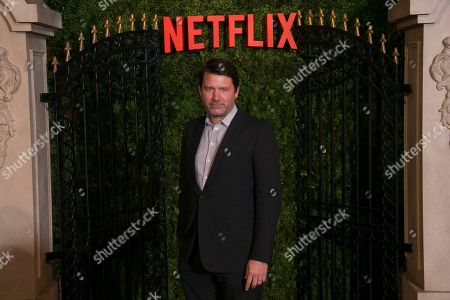 Benjamin Caron poses for photographers upon arrival at the World premiere of 'The Crown' season 3, in central London