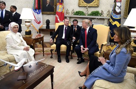 Stock Picture of Turkish first lady Emine Gulbaran, President Recep Tayyip Erdogan of Turkey, United States President Donald Trump and first lady Melania Trump in the Oval Office