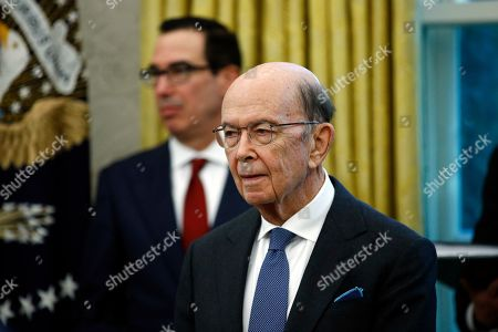 Commerce Secretary Wilbur Ross, front and Treasury Secretary Steven Mnuchin listen as President Donald Trump and Turkish President Recep Tayyip Erdogan meet in the Oval Office with Republican senators at the White House, in Washington