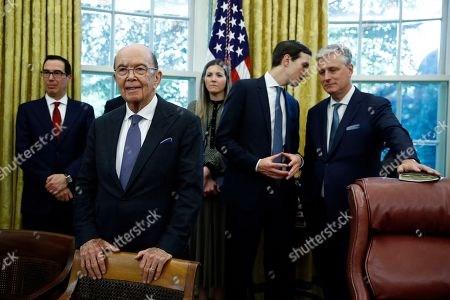 Stock Photo of Treasury Secretary Steven Mnuchin, left, Commerce Secretary Wilbur Ross, second from left, listen to President Donald Trump and Turkish President Recep Tayyip Erdogan as they meet in the Oval Office with Republican senators at the White House, in Washington, as senior adviser Jared Kushner talks with national security adviser Robert O'Brien, right