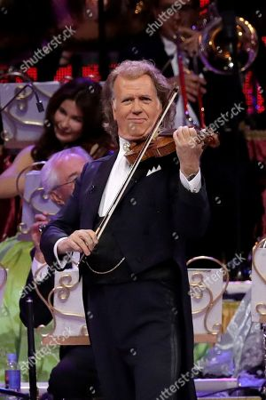 Stock Image of Dutch violinist Andre Rieu (C) performs with Johann Strauss Orchestra during a concert held at WiZink Center in Madrid, Spain, 13 November 2019.