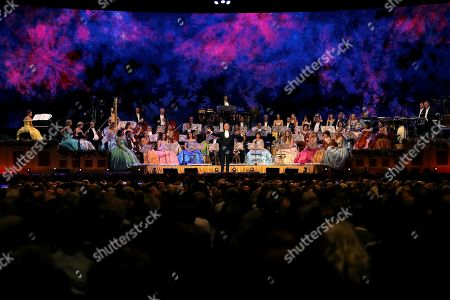 Stock Photo of Dutch violinist Andre Rieu (C) performs with Johann Strauss Orchestra during a concert held at WiZink Center in Madrid, Spain, 13 November 2019.