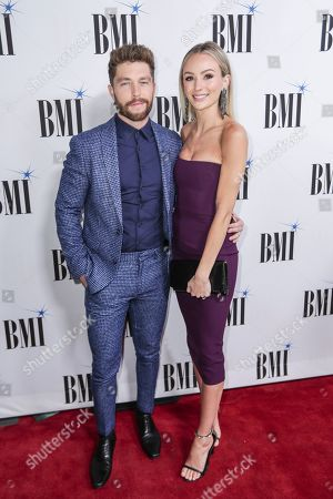Stock Photo of Chris Lane, Lauren Bushnell. Chris Lane, left, and his wife, Lauren Bushnell, arrive at 67th Annual BMI Country Awards ceremony at BMI Music Row offices, in Nashville, Tenn