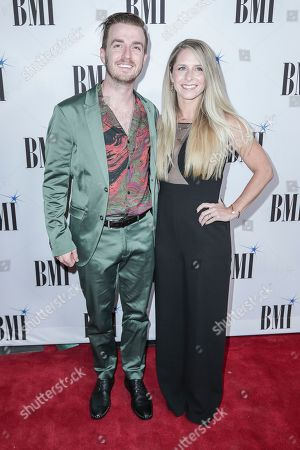 Brandon Lancaster and wife, Tiffany, arrive at 67th Annual BMI Country Awards ceremony at BMI Music Row offices, in Nashville, Tenn