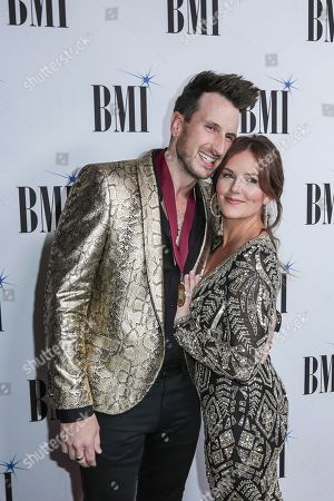 Russell Dickerson, left, and his wife, Kailey, arrive at 67th Annual BMI Country Awards ceremony at BMI Music Row offices, in Nashville, Tenn
