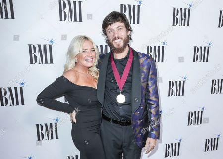 Chris Janson, right, and his wife, Kelly Lynn, arrive at 67th Annual BMI Country Awards ceremony at BMI Music Row offices, in Nashville, Tenn